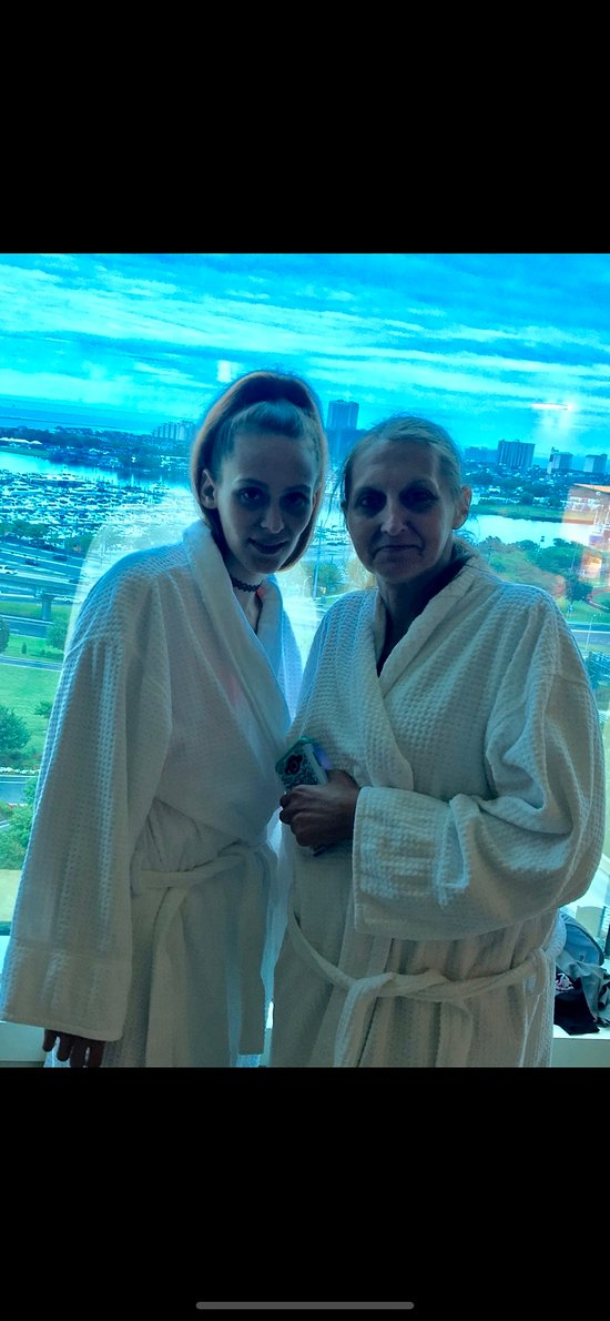 Me and Mommy chilling in our robes in the room before we go down to gamble