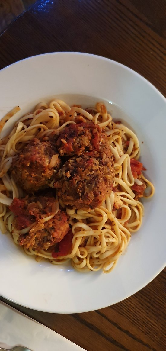 Chefs specials  Vegan meatballs in rich tomato sauce served with linguine