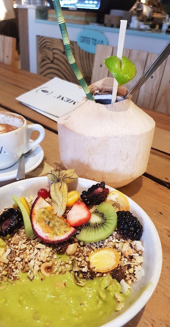 Green coconut bowl & fresh whole coconut