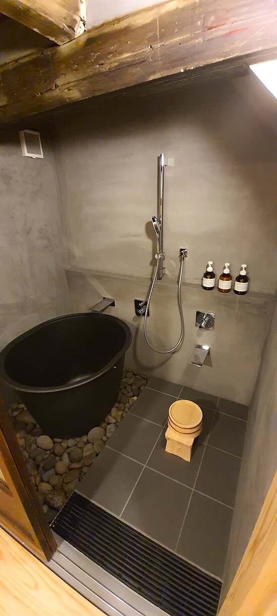 Traditional deep iron bathtub and shower room.