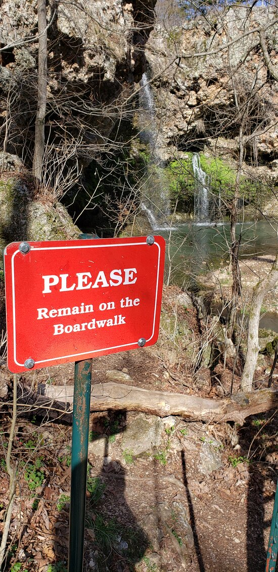 A sign by the falls asking Rednecks to stay on the Boardwalk.