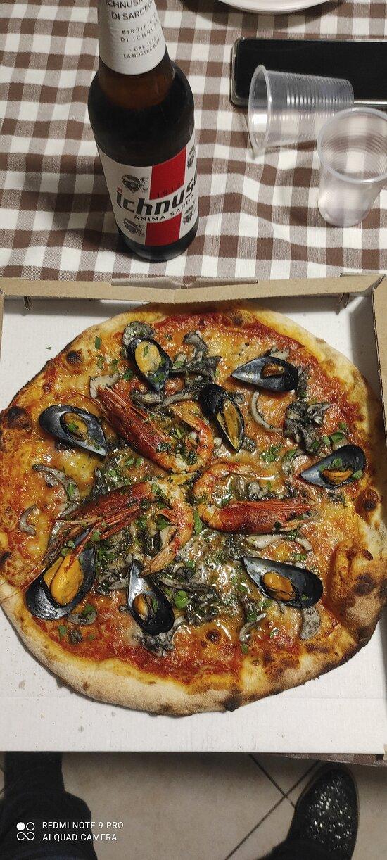 Pizza ai frutti di mare freschi, top!