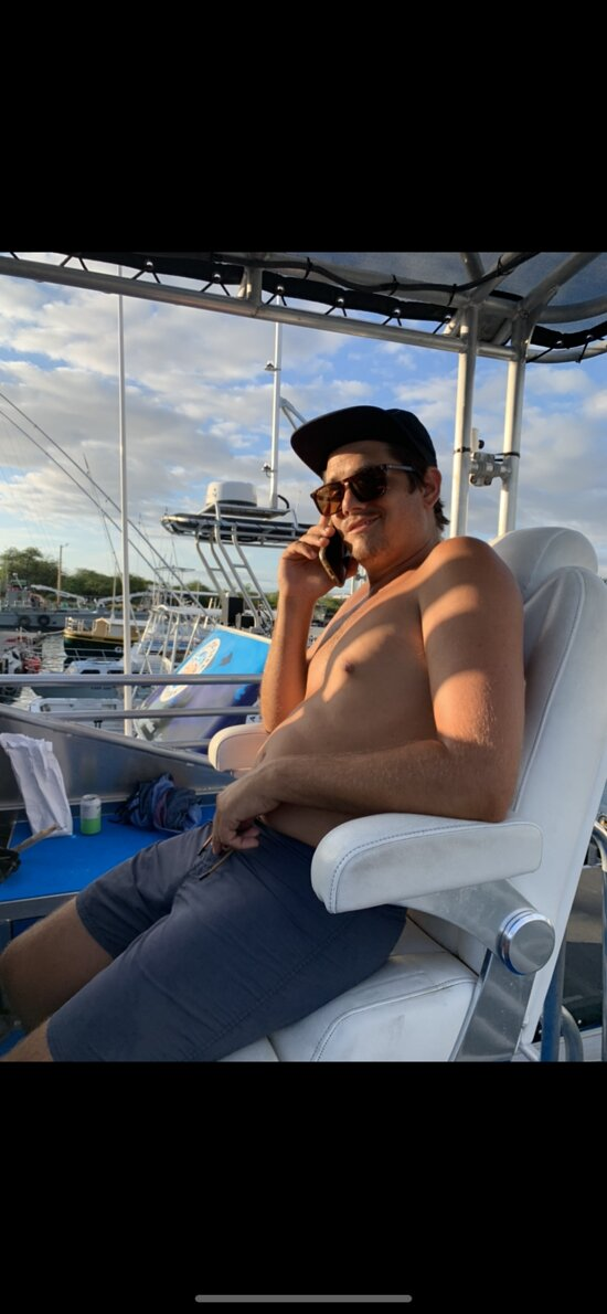 Mason, our conservation manager waitinn to depart for a 2-tank manta dive/snorkel (June, 2021)