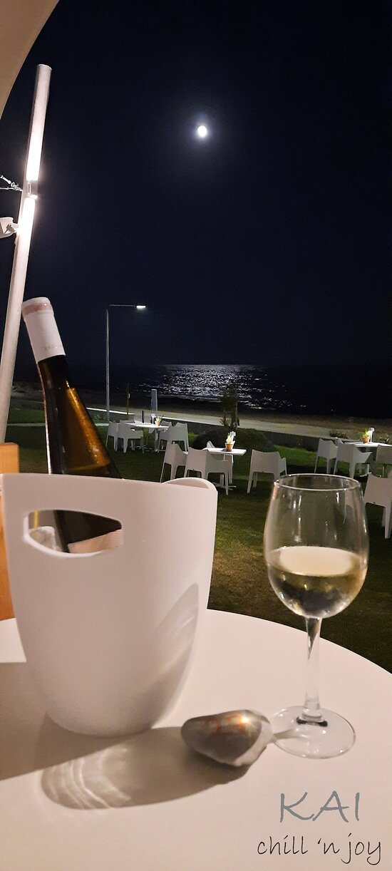 Glass of wine under the moonlight