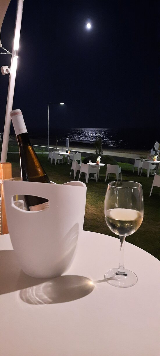 A glass of wine under the moonlight. What else?