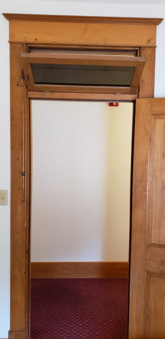 Transom above door for great airflow from hallway.