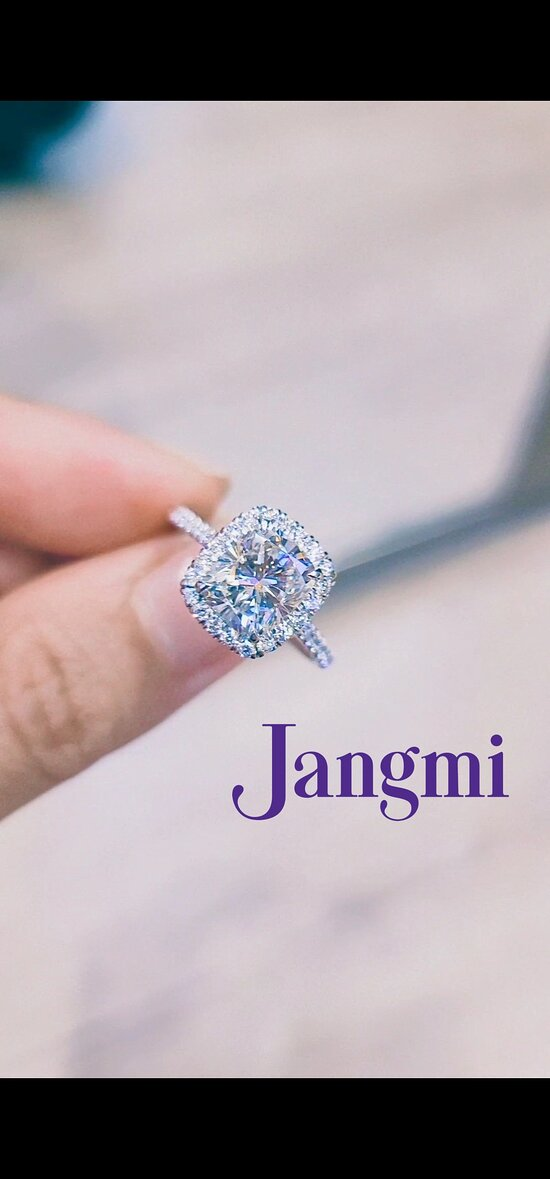 3ct elongated cushion cut on our Love Fancy Halo Pave setting in platinum.