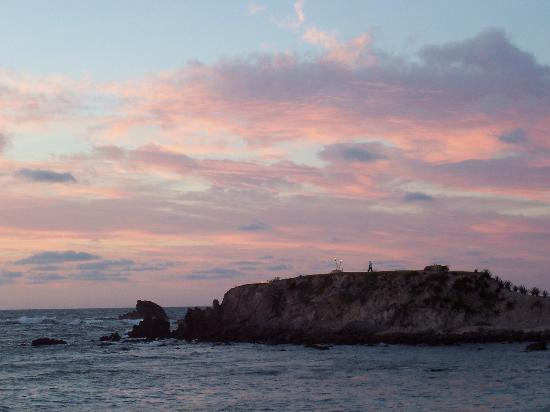 "Four Seasons Resort Punta Mita: Sunset over ""the rock""; preparing for dinner"