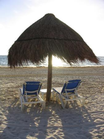 Excellence Riviera Cancun: 2 beach chairs at sunrise- there is waiter service at the pool and the beach