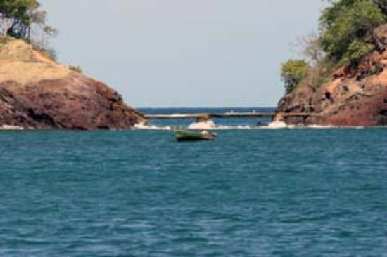 Sandals Grande St. Lucian Spa & Beach Resort: Man, boat, and the sea