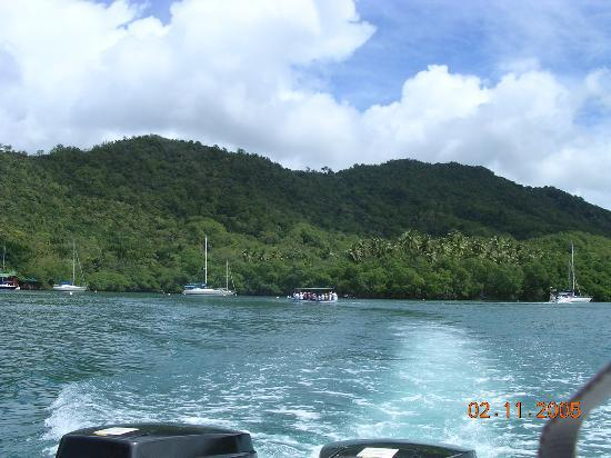St. Lucia: view from speedboat, ferry in distance.