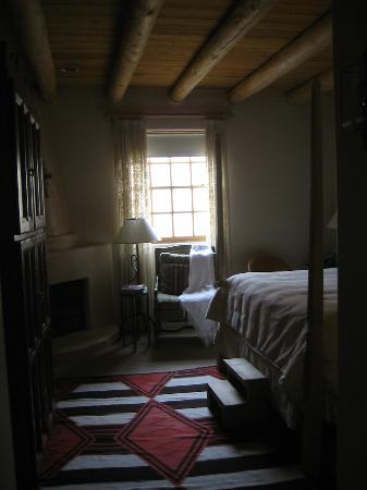 Rosewood Inn of the Anasazi: Our room - appears darker than it really was due to the window