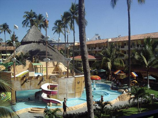 Explore The Beauty Of Caribbean: Amazing Kids Pool. Notice The Cruise Ship Behind The Hotel