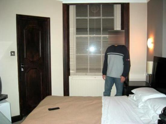 The Paddington Hotel: view of room standing at extra sink, bathroom is at the left of the foot of bed (literally)