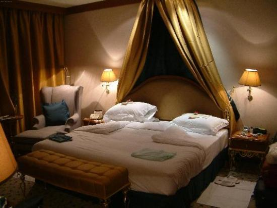 """Landmark Bangkok: the bedroom, separate from the sitting room. """"Turn-down"""" service by the chambermaid."""