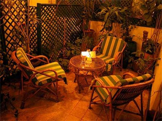 An evening view of a seating area on one of the terraces of the Hotel Longchamps in Cairo