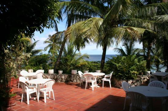 Black Rock, Tobago: The ground floor patio, where the resturant seating is when it's not raining.