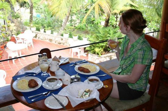 Black Rock, Tobago: Having breakfast on the upstairs patio.  Eggs and flying fish (you can choose bacon instead).