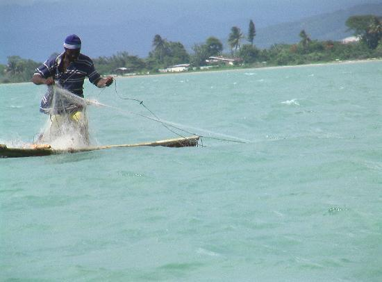 Negril, Jamaica: fisherman on the way from Peli Bar