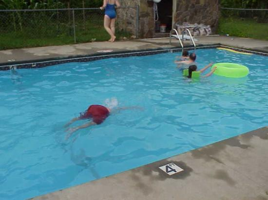 Riverside Motel: My son BOTTOMS UP in the pool.