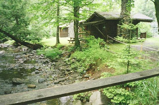 Rustic Log Cabins: stream and cabin