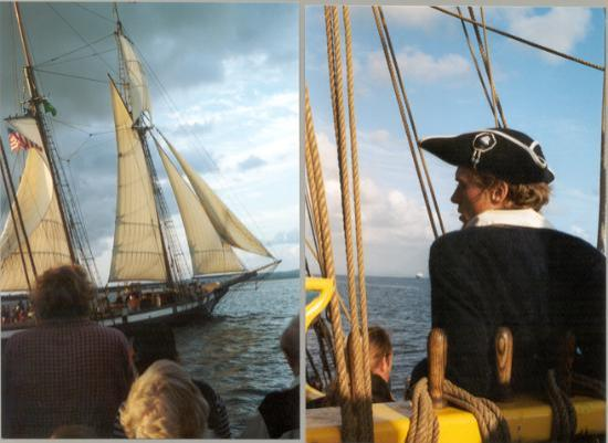 Aberdeen, WA: Lady Washington's captain eyes the Lynx at the end of the Pirate Battle Sailing out of...