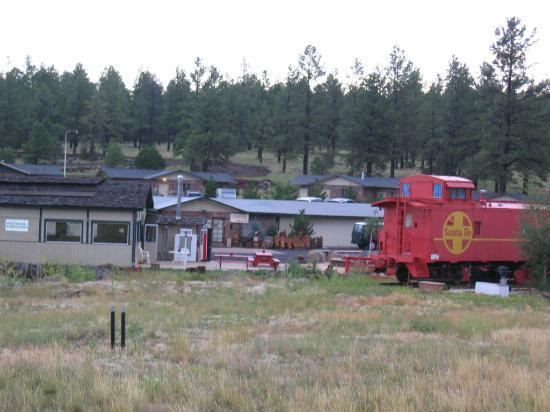 Canyon Caboose Bed & Breakfast: Caboose, Office, and Cottages in background