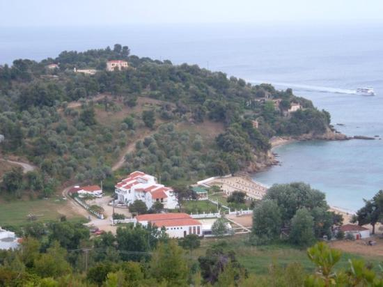 Troulos Bay Hotel: A distant view of the hotel and beach.