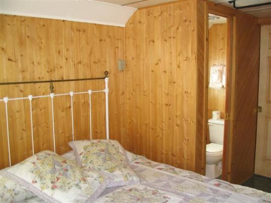 Train Station Inn: Here is the bedroom with a view into the bathroom
