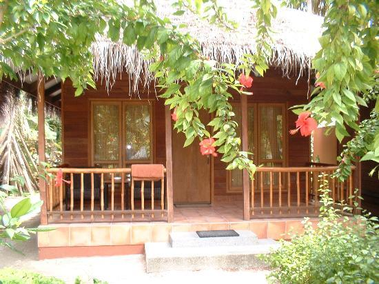 Kuramathi Island Resort: Superior Bungalow, open air shower is at the rear.