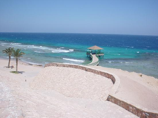 The Oberoi Sahl Hasheesh: hotel pier and snorkel area , tide coming in