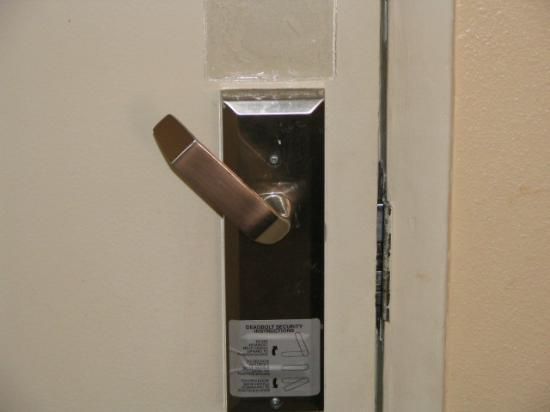 Holiday Inn Club Vacations at Desert Club Resort: View of doorhandle's deadbolt position & instructions in Unit 512 9/15/05