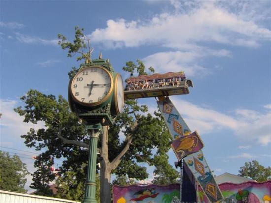 "Waldameer Park & Water World: Classic park clock with Ali Baba ""Magic Carpet"" Ride in the foreground"