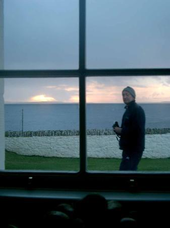 Cantick Head Lighthouse Cottages: The view from the cottage window - Derek in the way!