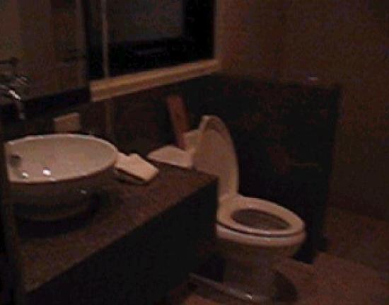 El Nido Resorts Miniloc Island: spanking clean bathroom with granite walls/floors and porcelain bowls