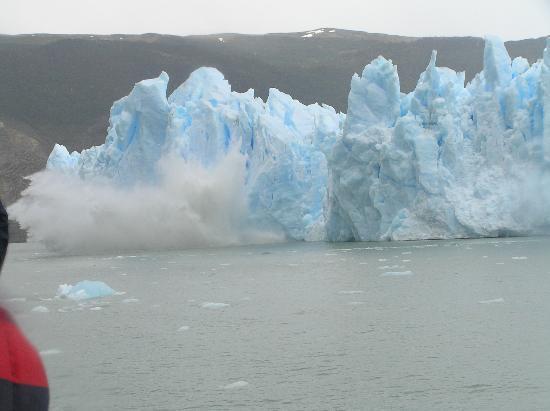 Glacier Grey: Splash from ice calving from the glacier
