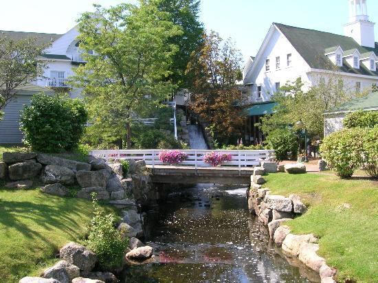 Meredith, NH: Mill Falls with Hotel to left and marketplace to right