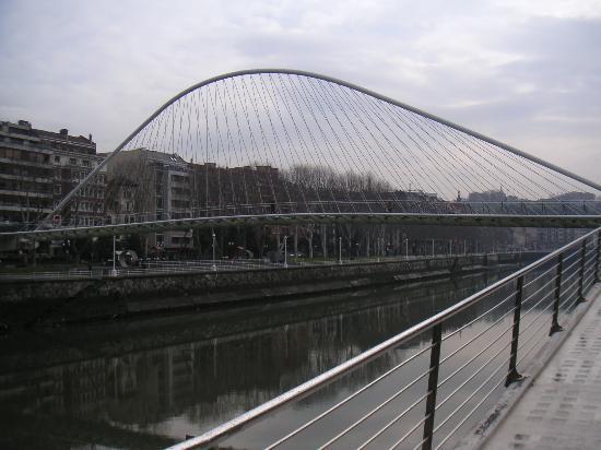 NH Collection Ria de Bilbao : footbridge over river next to Hotel