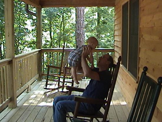 Old Smoky Mountain Cabins: My son and my father on the deck of the cabin