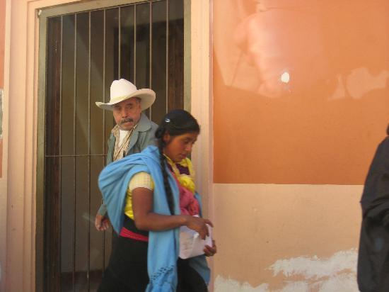 Hotel Real de Valle: lady in san cristobal clothing style with baby on back, typically selling woven items for...