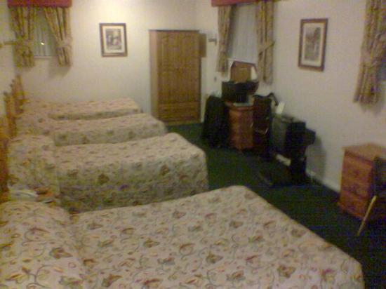 "The Ashburn Hotel: Photo of the ""family"" room with 3 single and 1 double bed, TV, en-suite, and storage"