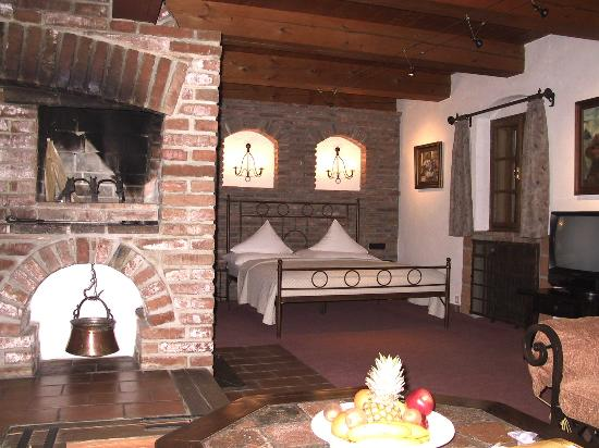 Romantik Hotel U Raka: U Raka bedroom bed (and fireplace)