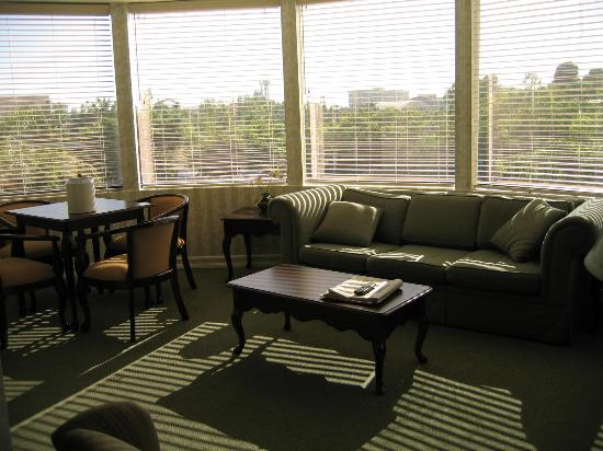 Carousel Inn and Suites: Dining area & living room with sofa sleeper with  - view of Disney
