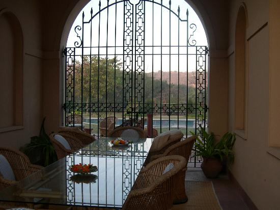 Tikli Bottom: courtyard dining with view of pool