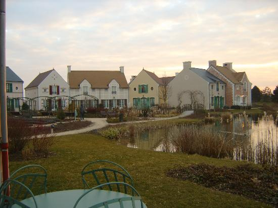 Marriott's Village d'lle-de-France : look over to the left of us our neighbors, the villas wrap around each area like a true...