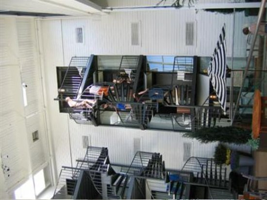 Weber's Boutique Hotel: Additional staircases around pool atrium, showing descending teens.