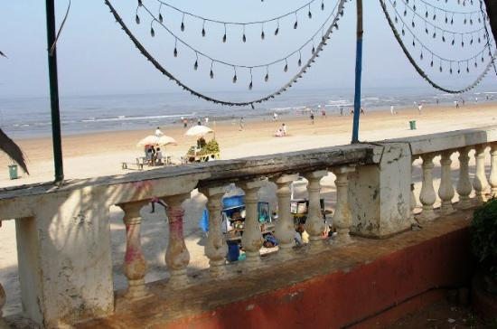 Juhu Hotel: View of beach from rear of hotel; OK view; please clean up the wretched and dirty columns on...