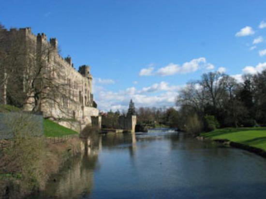 Birmingham, UK: Warwick Castle from the Island, with Avon River in the forground