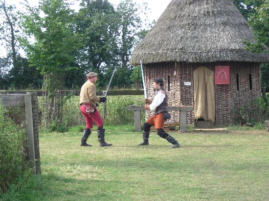 Long Melford, UK: men with swords