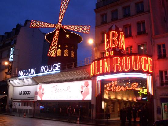 Parigi, Francia: The underworld nightclub of the past - now a neon paradise!